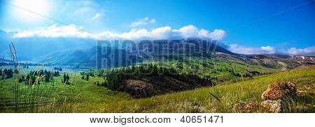Photo of beautiful mountain landscape, natural background, blue sky with bright sun light, fresh air, green pasture valley in Lebanon mountains, scenic place, traveling and active vacation concept