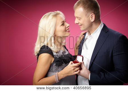 Elegant man making proposal to beautiful woman