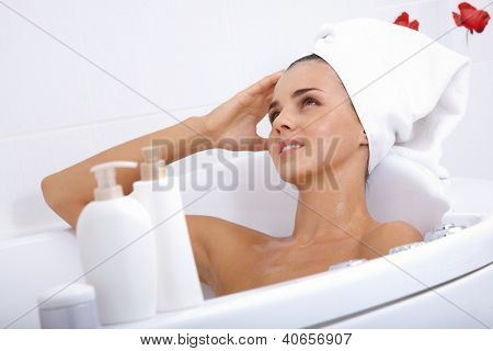 Image of serene woman having pleasant bath in spa salon