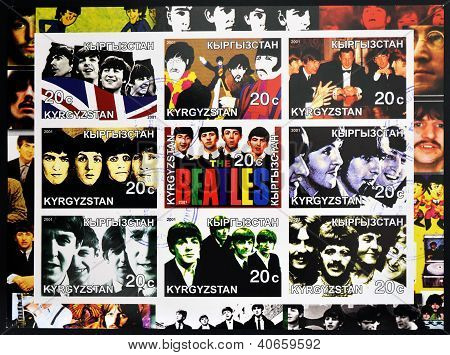 KIRZIGUISTAN - CIRCA 2001: Collection stamps printed in Kirziguistan shows the Beatles circa 2001