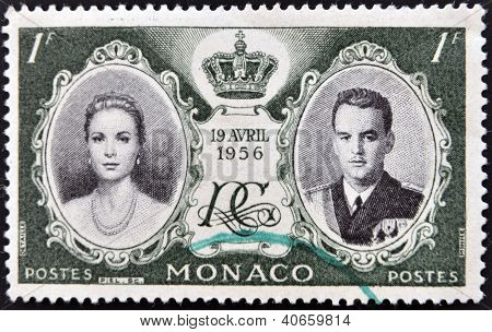 MONACO - CIRCA 1956: stamp printed in Monaco shows Princess Grace and Prince Rainier III circa 1956