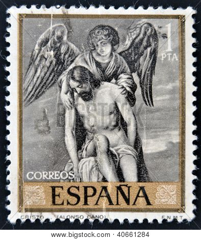 SPAIN - CIRCA 1912: A stamp printed in Spain shows draw by Alonso Cano Dead Christ Supported by an A