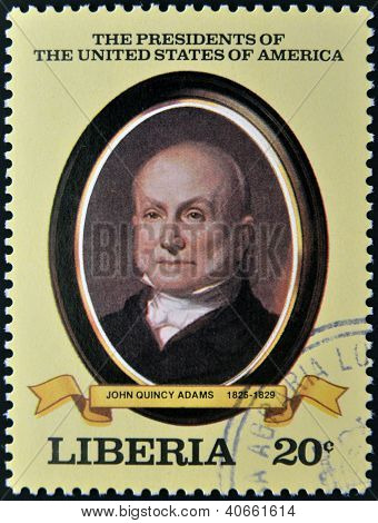 A stamp printed in Liberia shows President John Quincy Adams circa 1982.
