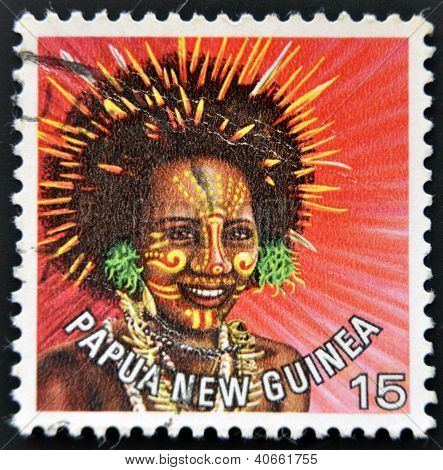 stamp printed in Papua New Guinea shows a woman in a feathered headdress from the area near Koiari