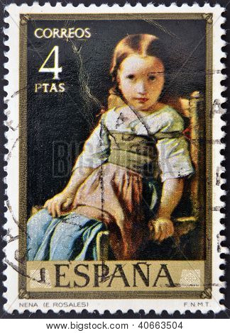 "SPAIN - CIRCA 1974: A stamp printed in spain shows the painting ""baby"" by Eduardo Rosales circa 1974"