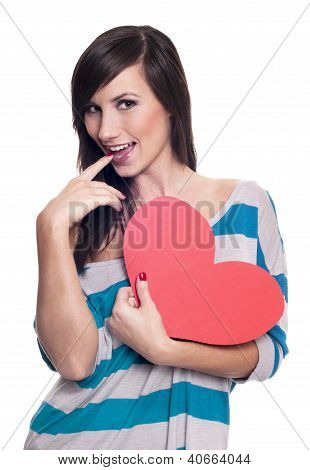 Young happy smiling Valentine woman with heart symbol