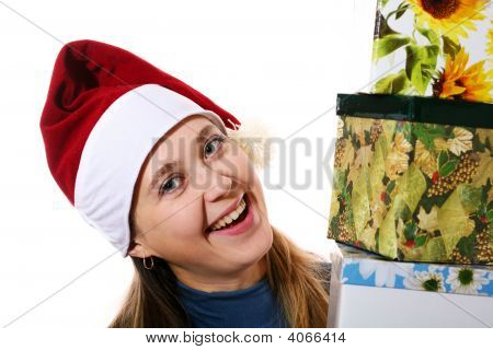 Smiling Girl In A Cap With Three Boxes