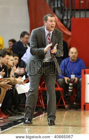 JAMAICA, NY-JAN 2: St. John's Red Storm head coach Joe Tartamella reacts on the sidelines against the Delaware Blue Hens at Carnesecca Arena on January 2, 2013 in Jamaica, Queens, New York.