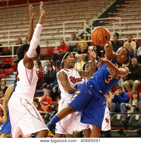 JAMAICA, NY-JAN 2: Delaware Blue Hens guard Jaquetta May (3) passes the ball around St. John's Red Storm during the first half at Carnesecca Arena on January 2, 2013 in Jamaica, Queens, New York.