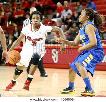 JAMAICA, NY-JAN 2: St. John's Red Storm guard Aliyyah Handford (3) dribbles around Delaware Blue Hens guard Jaquetta May (3) at Carnesecca Arena on January 2, 2013 in Jamaica, Queens, New York.