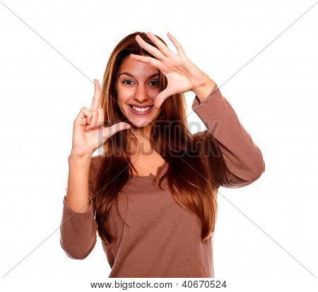 Smiling Young Woman Making A Frame With Her Hands