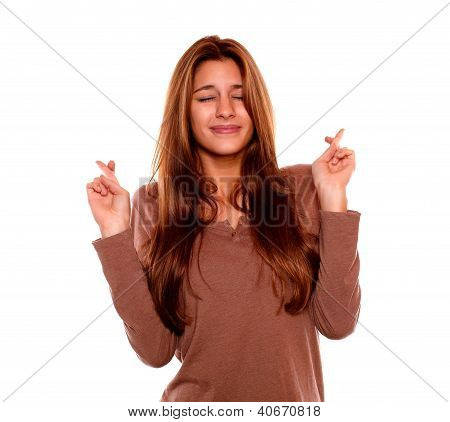 Smiling Woman With Closed Eyes Crossing Fingers