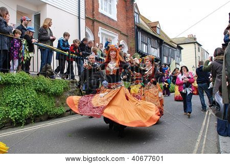 HASTINGS, ENGLAND - MAY 7: Dancers perform at a parade through the Old Town at the Jack In The Green festival on May 7, 2012 in Hastings, East Sussex. The event marks the May Day public holiday.