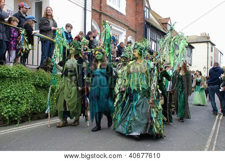 HASTINGS, ENGLAND - MAY 7: Costumed people parade through the Old Town at the Jack In The Green festival on May 7, 2012 in Hastings, East Sussex. The event marks the May Day public holiday.