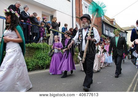 HASTINGS, ENGLAND - MAY 7: People in costumes parade through the Old Town at the Jack In The Green festival on May 7, 2012 in Hastings, East Sussex. The event marks the May Day public holiday.
