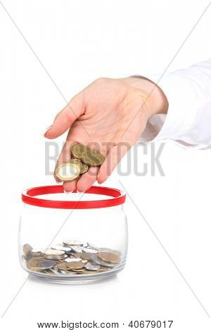 Woman hands with coins in glass jar isolated on white