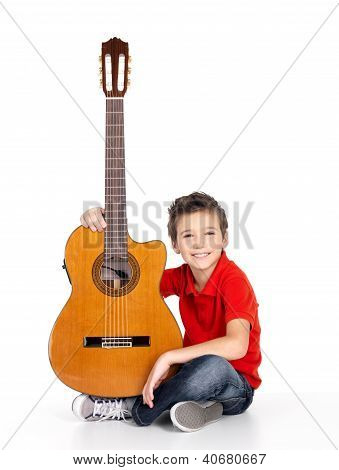 Handsome happy boy with acoustic guitar