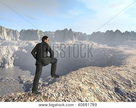 Conceptual 3D human or businessman in black suit looking over a dessert landscape with a blue sky after a climb