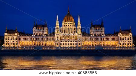 Hungarian parliament building and Danube river at night. Budapest, Hungary