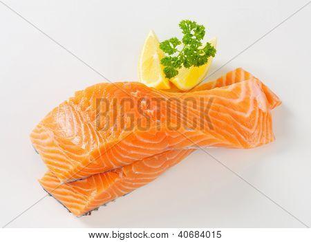 fresh salmon steak with lemon and parsley