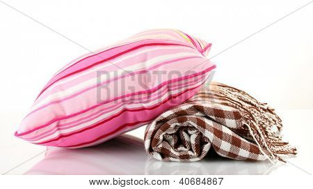 Warm plaid and color pillow, isolated on white