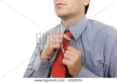 Man Adjusting Red Tie