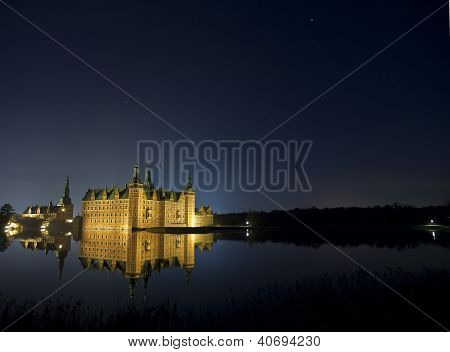 Frederiksborg Castle in winter night