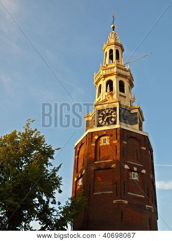Ancient Tower With Clock In The Historical City Center Of Amsterdam