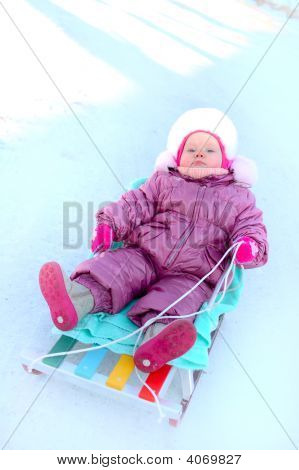 Pretty Little Girl Sit On Sled