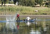 foto of nubian  - Traditional local egyptian nubian fishermen fishing in a wooden boat on the river nile - JPG