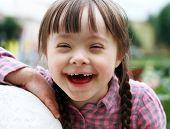 picture of playtime  - Portrait of beautiful young girl smiling outside - JPG