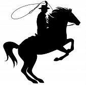 image of wrangler  - cowboy throwing lasso riding rearing up horse  - JPG