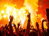 Photo of rock concert, music festival, New Year eve celebration, party in nightclub, dance floor, di