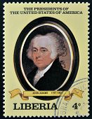 A stamp printed in Liberia shows President John Adams circa 1982