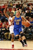 JAMAICA, NY-JAN 2: Delaware Blue Hens guard Kayla Miller (10) drives to the net past St. John's Red