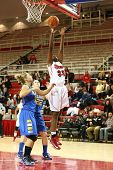 JAMAICA, NY-JAN 2: St. John's Red Storm forward Sandra Udobi (33) goes up for a shot against the Del