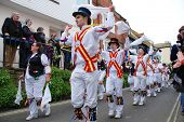 HASTINGS, ENGLAND - MAY 7: Morris dancers perform through the Old Town at the Jack In The Green fest