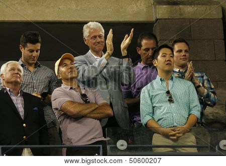 President Clinton applauding to US Open 2013 champion Serena Williams after her final match win