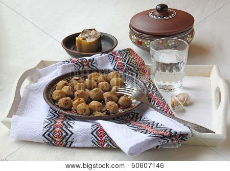 "Ukrainian National Food Of ""dumpling"" And Glass Of Vodka And Lobule Of Garlic On A Tray"
