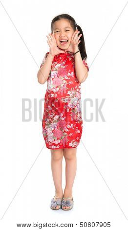 Full length China girl in traditional Chinese cheongsam dress shouting Happy Chinese New Year to everyone,  standing isolated on white background