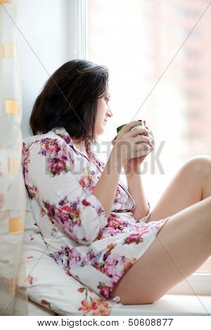 Girl On The Windowsill