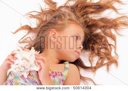 Calm Little Girl With Seashell