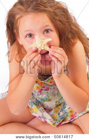 Funny Little Girl With Starfish