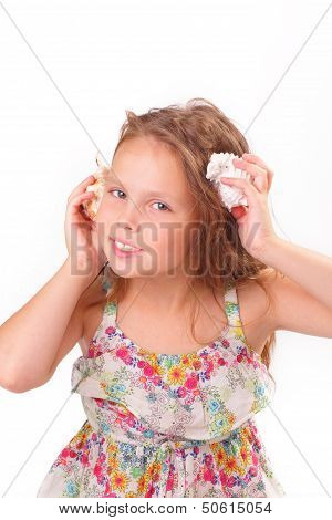 Pretty Little Girl With Starfish And Seashell