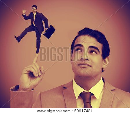 Businessman showing shrunk colleague with his briefcase on his finger
