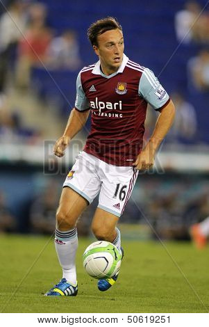 BARCELONA - SEPTEMBER, 5: Mark Noble of West Ham United in action during a friendly match against RCD Espanyol at the Estadi Cornella on September 5, 2013 in Barcelona, Spain