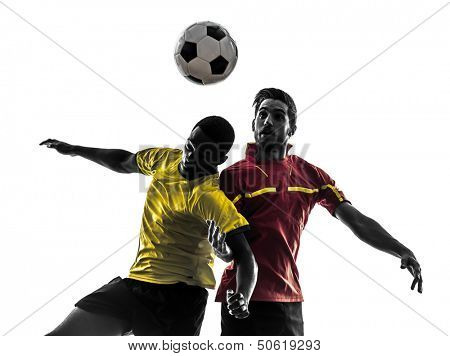 two men soccer player playing football competition fighting for a ball in silhouette on white background
