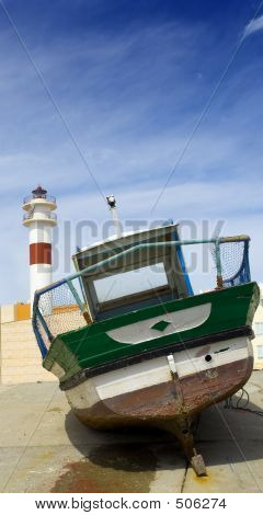 Boat And Lighthouse