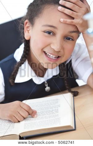 Pretty Young School Girl Reading A Book