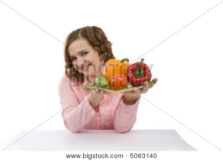 Housewife Is Holding The Plate With Pepper, Tomato, Cucumber.